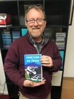 Happy author with Novel off the press.